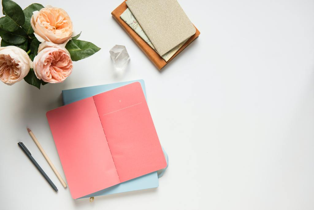 Image of Pink Journal, Flowers and a Pen